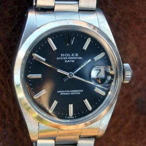 "1975 Rolex Oyster Perpetual Date Chronometer Reference 1500 with Rare ""Wide Boy"" Black Dial on Original Rolex Oyster Bracelet"