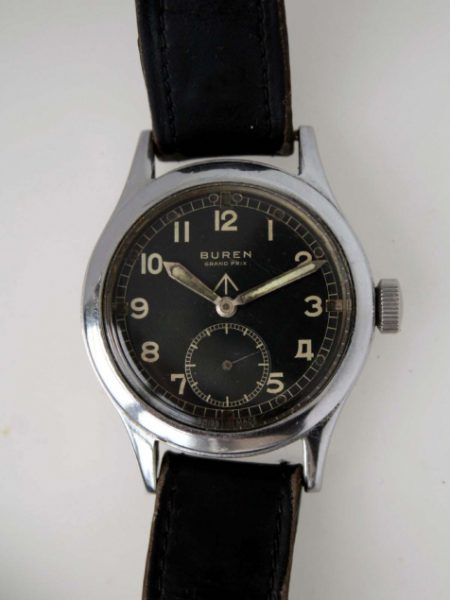1943 Grand Prix WWW British Military Officers Watch one of the Dirty Dozen With Military Issue Markings on Case-Back and Braodarrow on Original Dial. Original Fixed Bar Military Lugs and Crown