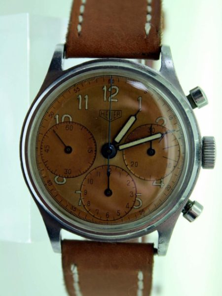 1943 WW2 Pilot's Chronograph with Three Rare Oversized Sub-Dials. Large Screw-Back Stainless Steel Case with Round Pushers. Valjoux Movement. Comes on Steel Heuer Buckle