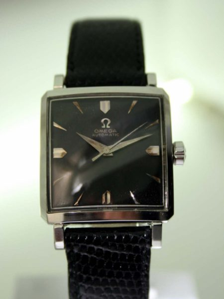 1957 Automatic All Steel Square Case with Horn Lugs and Omega Signed Crown Swiss Made Original Omega Factory Finish Black Dial with Silver Hour Markers 20 Jewel Cal 471 Automatic Movement