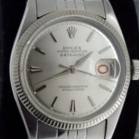 "1957 Rare Early Stainless Steel Datejust. Alternating Red and Black ""Rolulette"" Date. Dauphine Hands. Semi-Bubbleback Case Ref. 6605. All Original Stunning Big Collectible Rolex in Rare Mint Condition."