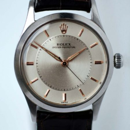 "1957 Rolex Oyster Perpetual ""Bullseye"" Mint 100% Original Condition with Rose Gold Hour Markers and Dauphine Hands. Rolex Flat-Sided Case Ref. 6532. Cal. 1030"