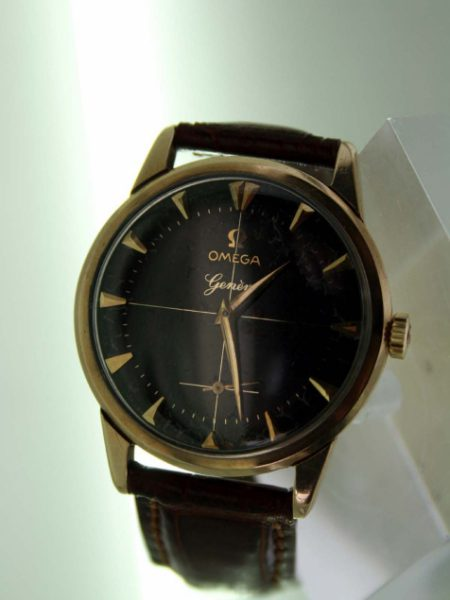 1960 Geneve Solid Gold Case 30MM Movement Rare Omega Factory Black Original Dial with Cross-Hairs and Applied Solid Gold Arrowhead Hour Markers and Dauphine Hands Original Omega Signed Winding Crown
