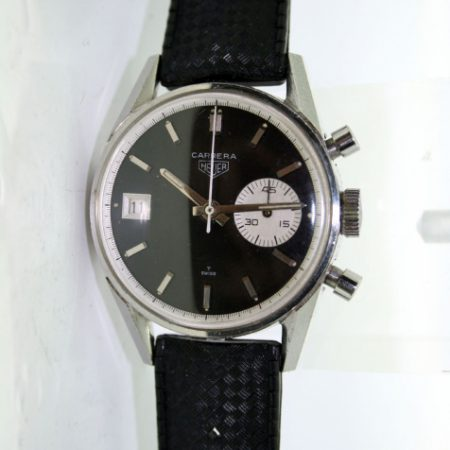 1960's Carrera 45 Dato Ref. 3147N. Mint Original Superb Black Dial with Contrasting One White Sub-Dial and Date Window at 9. First Chronograph with a Date Function. Comes with Heuer Buckle