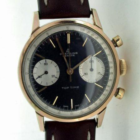 1960's Top Time Geneve Chronograph. Collectible Two Register Black Dial Top Time with White Outer Tachymeter Rim. Mint Condition. Original Breitling Signed Winding Crown and Breitling Strap.