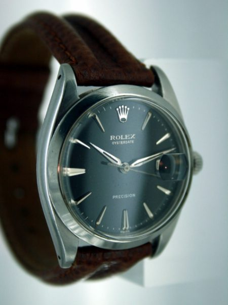 1961 Oysterdate All Steel with Original Black and Silver Rolex Signed Dial with Early Dagger-Style Rolex Hands Silver Hour Markers and Rolex Signed Oyster Screw-Down Crown. Rolex Manual Wind Movement