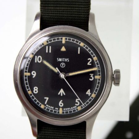 1969 British Army Military Issued Wristwatch Ref. W10/6645 with Hacking Seconds and Broadarrow and Military Markings on Case-Back. Superb Example on Black Military Strap
