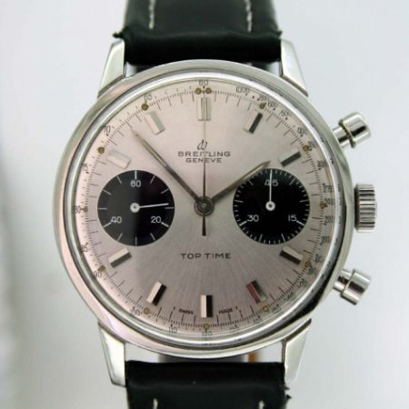1969 Geneve Top Time Chronograph with Original Silver Sunburst Finish Dial with Two Black Sub-Dials. Stainless Steel Chromed Case. Mint Perfect Condition on Breitling Buckle