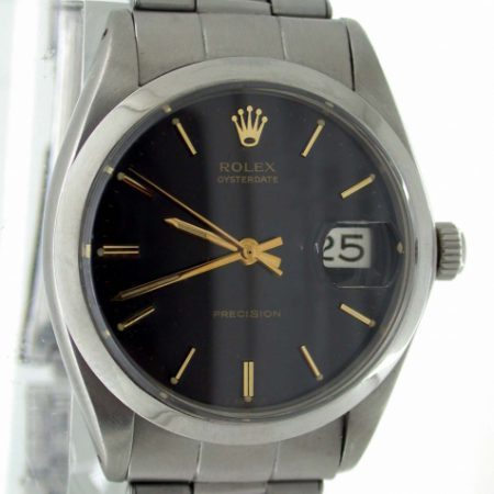 1969 Oysterdate Ref. 6694 with Gloss Black and Gilt Original Rolex Dial. Rolex Signed Oyster Screw Down Crown. Original 1960's Mint Condition Rolex Steel Bracelet