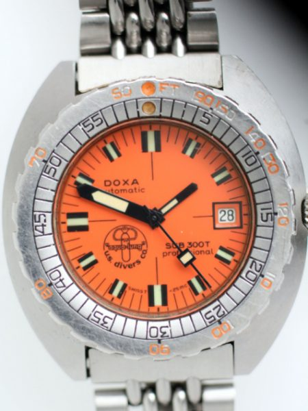 1970s Doxa Sub300T Professional Desigend by Jacques Cousteau with Orange Dial with US Divers Co LogoThis Watch comes on its Original Divers Extention Bracelet