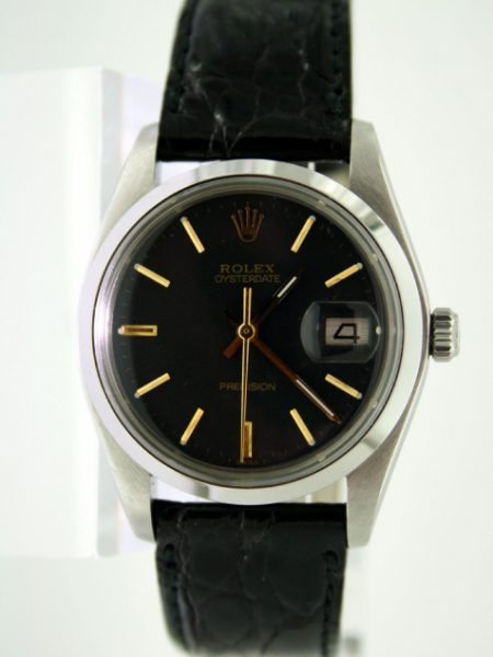 1978 Oysterdate with Sort After Black and Gilt Dial with Gold Hour Markers and Hands Ref. 6694 All Steel Rolex Case Watch is in Mint Original Condition and on New Black Crocodile Skin Strap