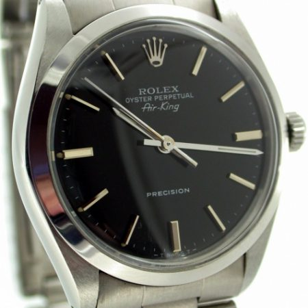 Beautiful 1986 Oyster Perpetual Air King Precision Black Dial with Silver Baton Hour Markers. All Original Mint Condition Throughout. Original Oyster Bracelet and Rolex Box