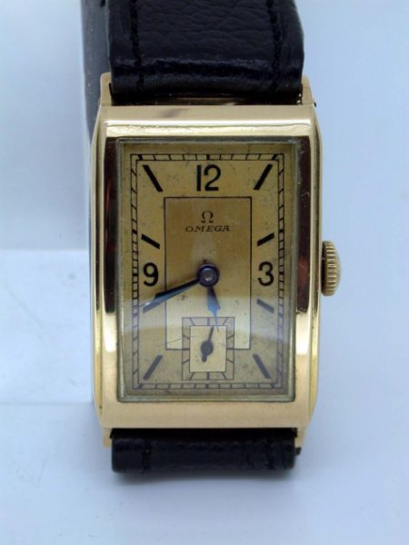 Rare 1930's Solid 18k Yellow Gold Art Deco Gentleman's Wristwatch with High Quality Omega Cal. 20F Movement. Original Two-tone Dial. Stunning Curved-Back Gold Case!