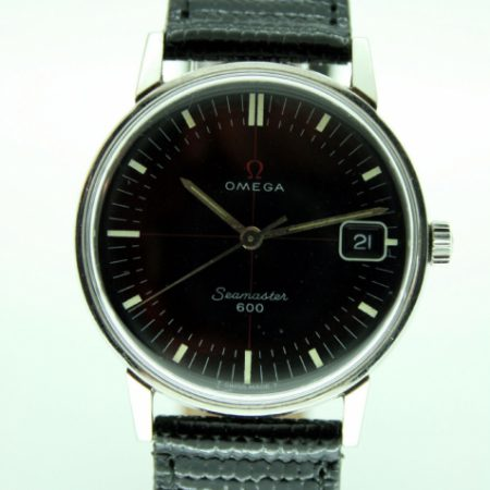 Vintage 1965 Seamaster 600 with Original Black Dial with Red Cross-Hairs and Calendar Date Window at 3. Omega Seamonster Logo on Case-Back. Original Omega Signed Winding Crown. Beautiful Dial