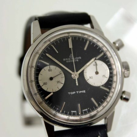 """Vintage 1967 Top Time Geneve Ref. 2002 in Steel with Perfect Original """"James Bond"""" Black Dial with Two Silver Sub-Dials Original Signed Crown Breitling Stitched and Padded Strap and Buckle"""
