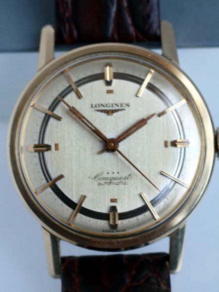c1950 18k Gold Capped Steel Conquest Automatic in Near NOS Condition with Original Stepped Dial and Beautiful Fish Logo Case-Back and NOS Longines Strap and Buckle